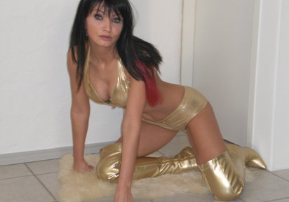 Sassy mature momma shows off her curves in gold lingerie and boots.